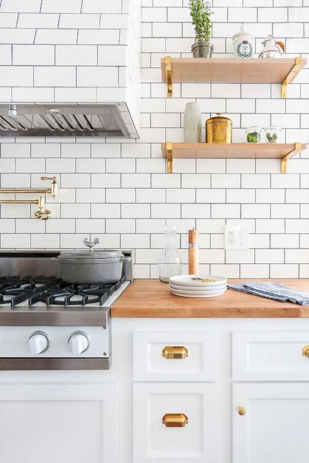 white kitchen with subway tile black grout white kitchen